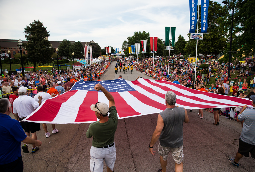 Members of the Elks Lodge 158 enter the fairgrounds with a massive American Flag during the 2015 Illinois State Fair Twilight Parade at the Illinois State Fairgrounds, Thursday, Aug. 13, 2015, in Springfield, Ill. Justin L. Fowler/The State Journal-Register