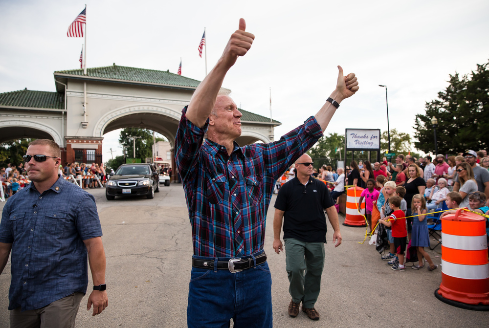 Illinois Gov. Bruce Rauner gives a double thumbs up as he enters the Main Gate during the 2015 Illinois State Fair Twilight Parade at the Illinois State Fairgrounds, Thursday, Aug. 13, 2015, in Springfield, Ill. Justin L. Fowler/The State Journal-Register