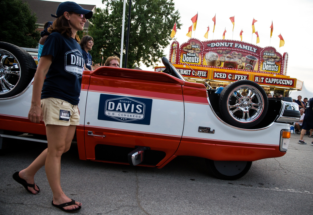 An upside down truck rolls down Main Street for U.S. Rep. Rodney Davis during the 2015 Illinois State Fair Twilight Parade at the Illinois State Fairgrounds, Thursday, Aug. 13, 2015, in Springfield, Ill. Justin L. Fowler/The State Journal-Register