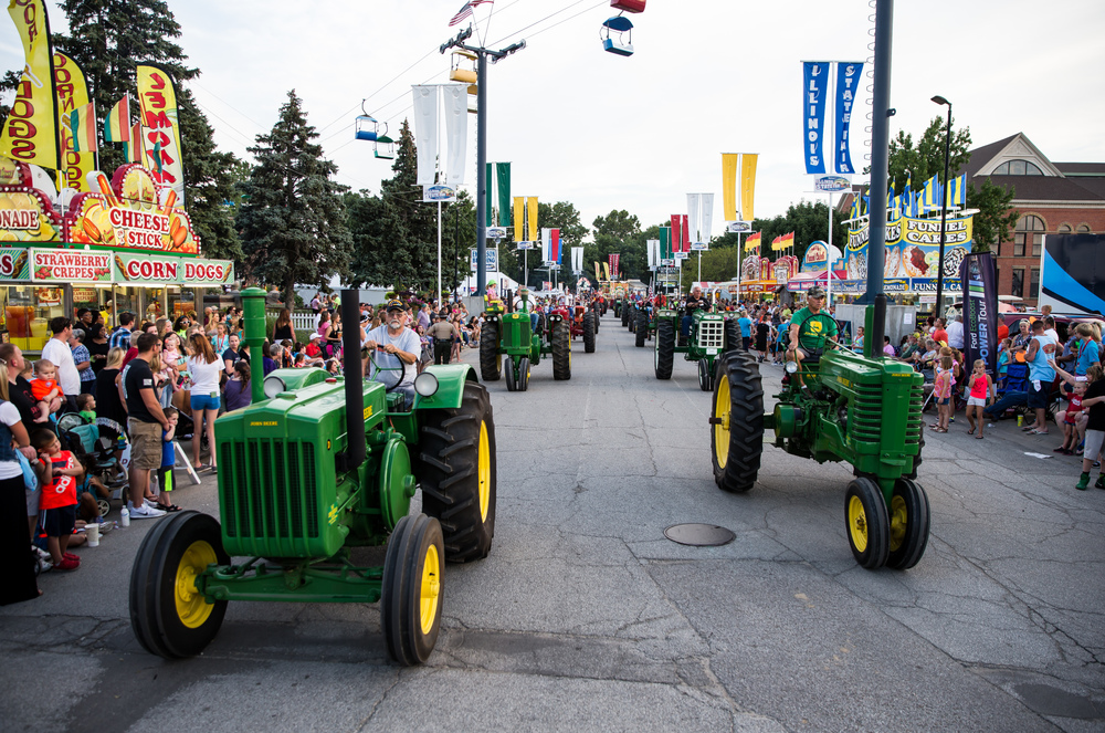 The antique tractors roll down Main Street during the 2015 Illinois State Fair Twilight Parade at the Illinois State Fairgrounds, Thursday, Aug. 13, 2015, in Springfield, Ill. Justin L. Fowler/The State Journal-Register
