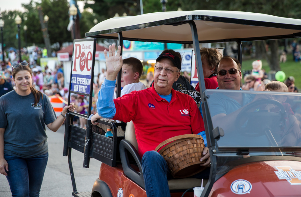 State Rep. Raymond Poe waves to the crowd as he passes the announcers table during the 2015 Illinois State Fair Twilight Parade at the Illinois State Fairgrounds, Thursday, Aug. 13, 2015, in Springfield, Ill. Justin L. Fowler/The State Journal-Register