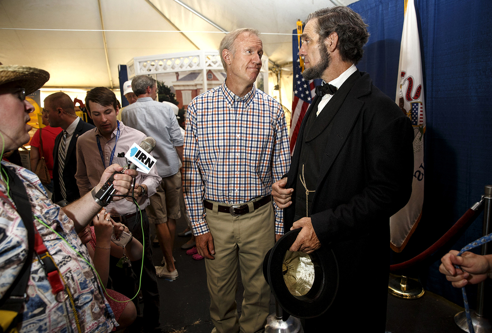 Illinois Gov. Bruce Rauner visited with Abraham Lincoln, portrayed by Randy Duncan of Carlinville, Ill., at the Governor's Tent at the Illinois State Fairgrounds Friday, Aug. 14, 2015. Ted Schurter/The State Journal-Register