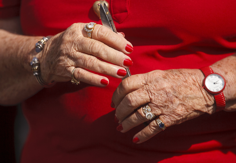 Evelyn Brandt Thomas,  co-owner of Brandt Consolidated Inc., sports Brandt-red fingernails as she attends the ribbon cutting to officially open the 2015 Illinois State Fair Friday, Aug. 14, 2015.  Ted Schurter/The State Journal-Register