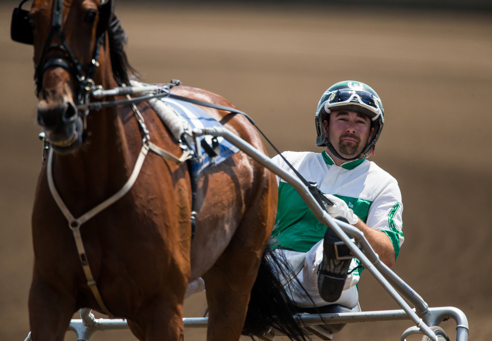 Pat Curtin drives Sara The Spy back to the winner's circle after taking the victory in the Illinois State Fair Stake Fillies and Mares (Illinois Concieved & Foaled) during harness racing at the Illinois State Fairgrounds, Friday, Aug. 14, 2015, in Springfield, Ill. Justin L. Fowler/The State Journal-Register