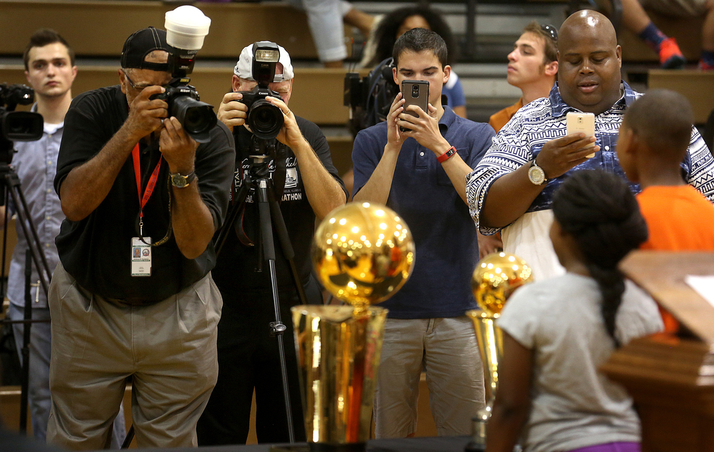 Those attending the ceremony had the opportunity to have their photograph taken with both the NBA team championship and MVP trophies. David Spencer/The State Journal-Register