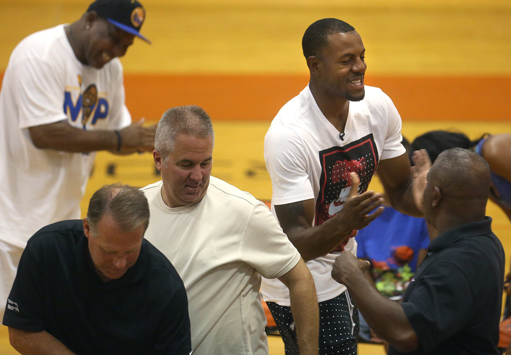 Andre Iguodala shakes hands with some of his former coaches going back to grade school before the start of the ceremony.  David Spencer/The State Journal-Register