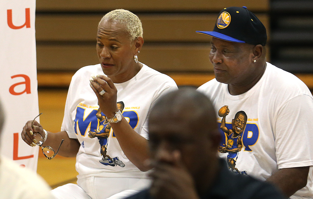 Andre Iguodala's mother, Linda Shanklin, wipes away a tear while seated next to husband Leonard Shanklin during the ceremony. David Spencer/The State Journal-Register