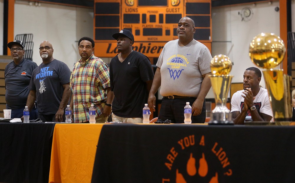 Some of Andre Iguodala's former basketball coaches stand while being recognized during the ceremony. David Spencer/The State Journal-Register