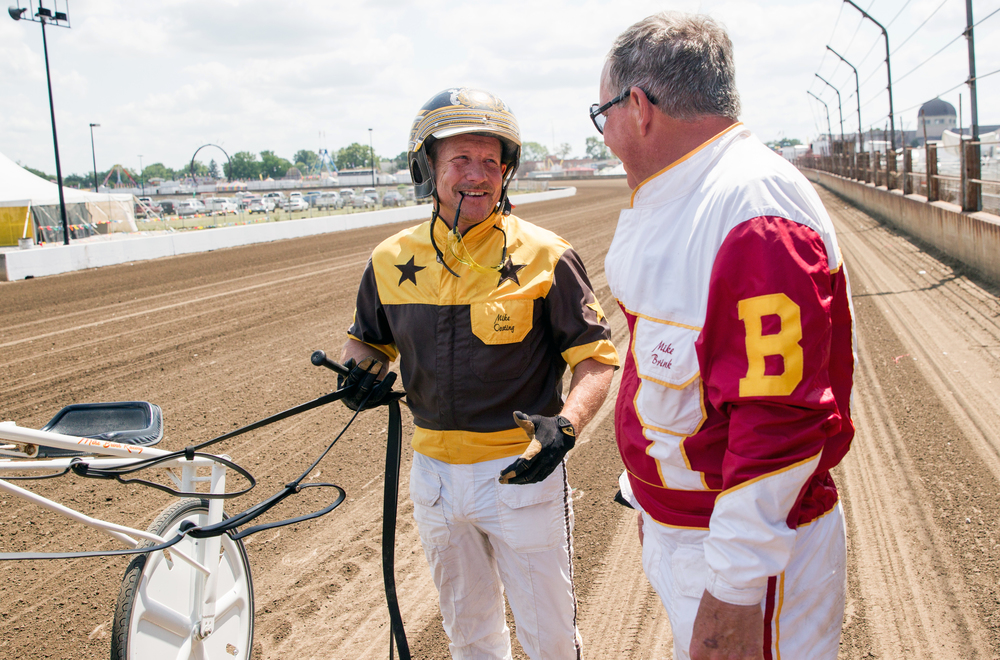 Driver Michael Oosting talks with trainer Mike Brink after King Mufasa won the Illinois State Fair Stake Horses & Geldings (Illinois Conceived & Foaled) during harness racing at the Illinois State Fairgrounds, Saturday, Aug. 15, 2015, in Springfield, Ill. Justin L. Fowler/The State Journal-Register