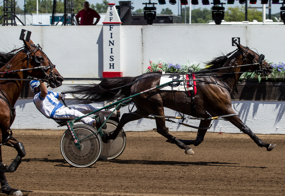 Driver Jeffrey Kirk takes home the victory with Cole Heat in the Illinois State Fair Stake Horses & Geldings (Illinois Conceived & Foaled) during harness racing at the Illinois State Fairgrounds, Saturday, Aug. 15, 2015, in Springfield, Ill. Justin L. Fowler/The State Journal-Register