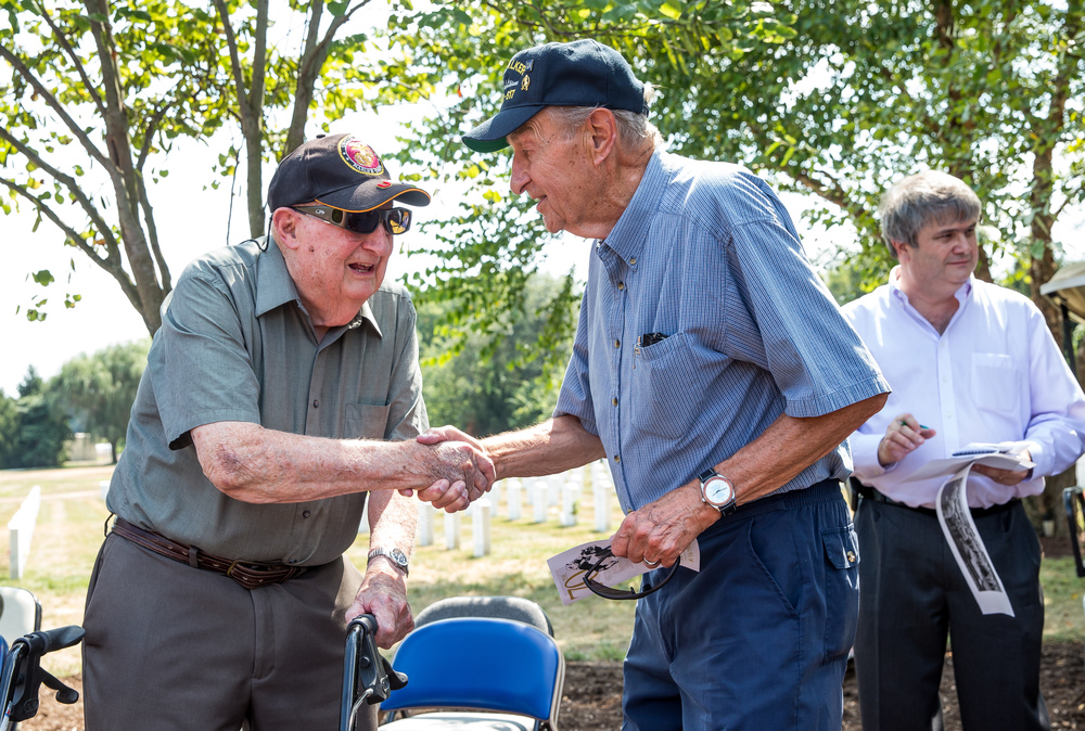 Jesse Beanblossom, left, a WWII Marine Corps veteran, visits with Lee Fuchs, a fellow WWII Navy veteran, after a wreath laying ceremony to commemorate the 70th anniversary of the end of WWII at Camp Butler National Cemetery, Sunday, Aug. 16, 2015, in Springfield, Ill. Beanblossom served in Guadalcanal and Fuchs served in the Pacific on the USS Walker. Justin L. Fowler/The State Journal-Register