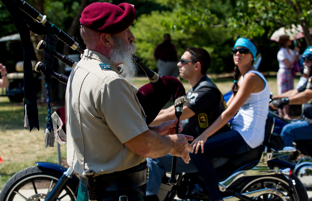 Larry Creviston plays the bagpipes as members of the Patriot Guard and American Legion Motorcycle Rides make their way in for a ceremony to commemorate the 70th anniversary of the end of WWII at Camp Butler National Cemetery, Sunday, Aug. 16, 2015, in Springfield, Ill. Justin L. Fowler/The State Journal-Register