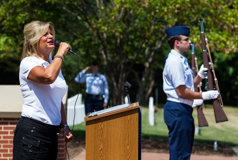 Deanna Cagley sings the National Anthem during a wreath laying ceremony to commemorate the 70th anniversary of the end of WWII at Camp Butler National Cemetery, Sunday, Aug. 16, 2015, in Springfield, Ill. Justin L. Fowler/The State Journal-Register