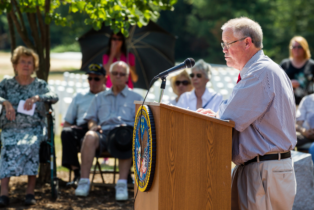"Dr. Leslie J. ""Jack"" Fyans Jr., the son of WWII veterans Lt. Leslie J. and Lt. Anntonette Marie Picco Fyans, tells the story of how is his parents met in WWII during a ceremony to commemorate the 70th anniversary of the end of WWII at Camp Butler National Cemetery, Sunday, Aug. 16, 2015, in Springfield, Ill. Justin L. Fowler/The State Journal-Register"