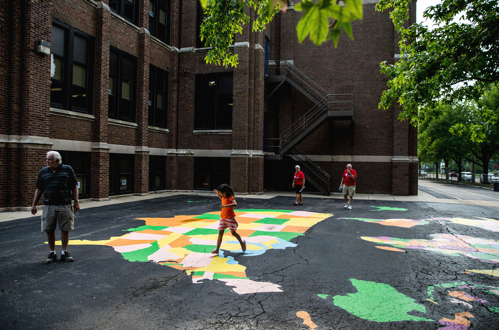 A mural of the world was painted near the playground during the Springfield Sharefest makeover of Feitshans Elementary School, Sunday, Aug. 9, 2015, in Springfield, Ill. Justin L. Fowler/The State Journal-Register