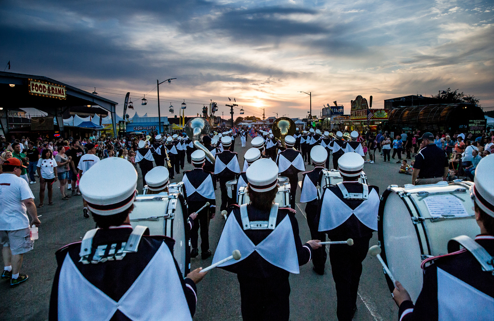 The Rochester High School Marching Band makes their way through the fairgrounds as the sun begins to set during the 2015 Illinois State Fair Twilight Parade at the Illinois State Fairgrounds, Thursday, Aug. 13, 2015, in Springfield, Ill. Justin L. Fowler/The State Journal-Register