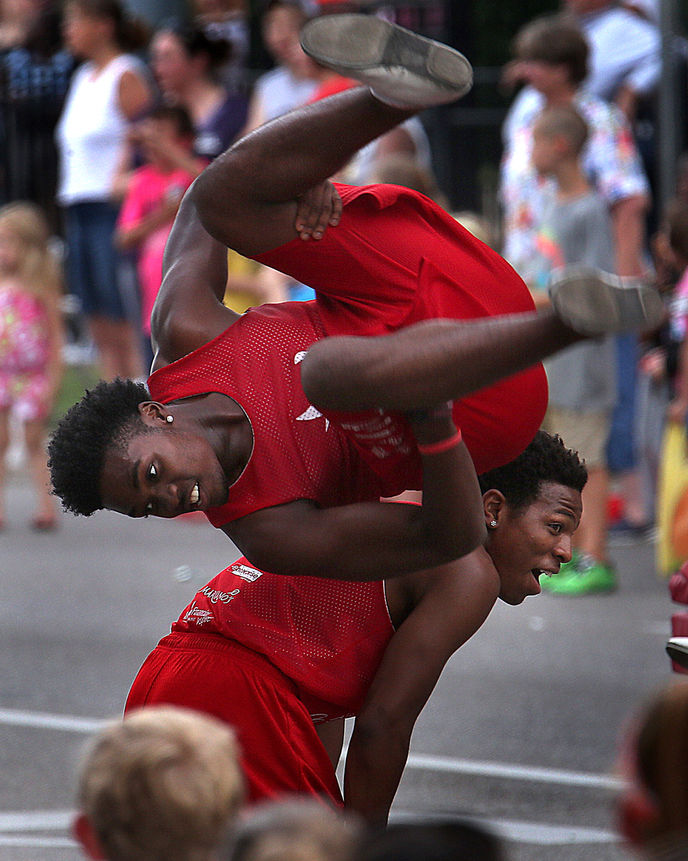 Members of the Jesse White Tumblers perform during the Twilight Parade, kicking off the 2015 Illinois State Fair Thursday, Aug. 13, 2015. David Spencer/The State Journal-Register