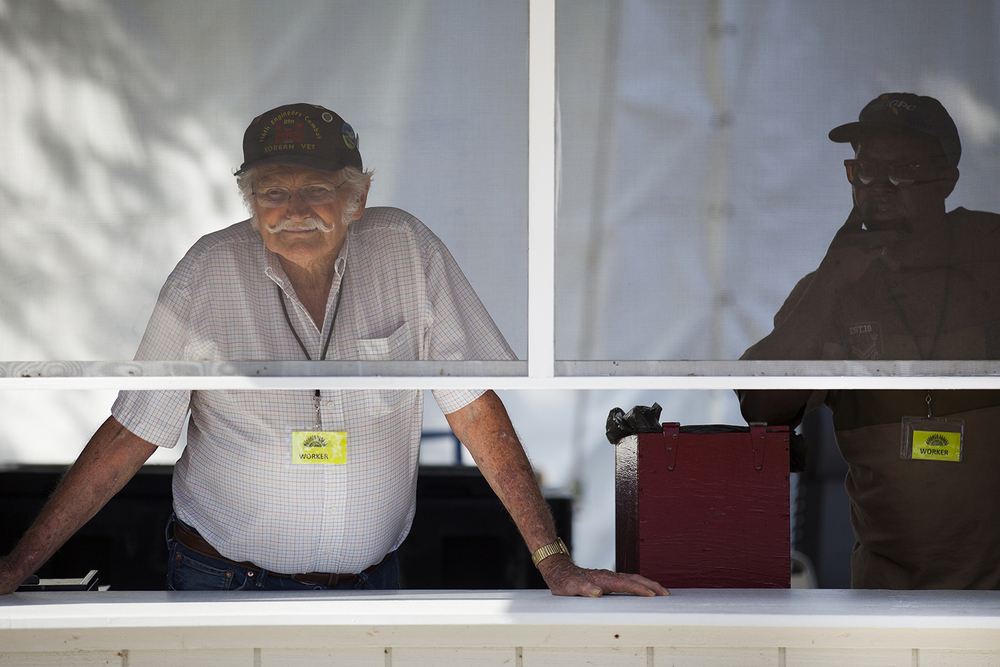 Fred Still, left, and Rolland Turner man the beer tent in Ethnic Village at the Illinois State Fair Monday, August 17, 2015. The men are part of the Korean War Veterans Association who took a shift in the tent. Rich Saal/The State Journal-Register