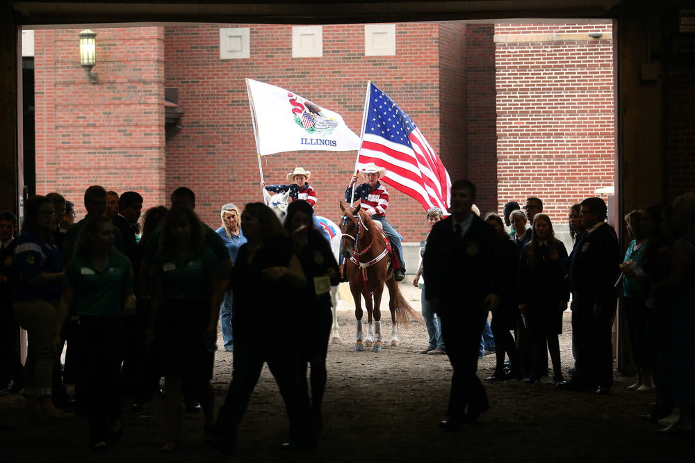 Brothers Bronc Bogner at left and Lance Bogner prepare to enter the Coliseum with the Illinois and American flags before the start of the auction late Tuesday afternoon. The Governor's Sale of Champions took place in the Coliseum at the Illinois State Fair in Springfield on Tuesday, August 18, 2015. Proceeds from the sale are divided between the individual owners, Illinois FFA and Illinois 4-H programs. David Spencer/The State Journal-Register