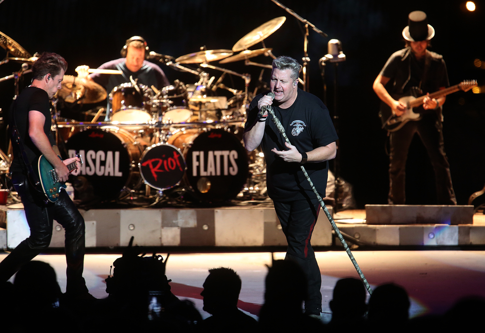 Gary LeVox at center and Joe Don Rooney at left perform Tuesday night. The country music trio Rascal Flatts were the headliners on the Grandstand Stage at the Illinois State Fairgrounds in Springfield on Tuesday evening, August 18, 2015. David Spencer/The State Journal-Register