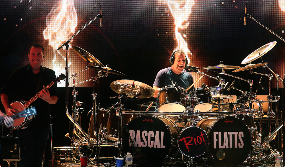 Drummer and bandleader Jim Riley rocks out Tuesday night. The country music trio Rascal Flatts were the headliners on the Grandstand Stage at the Illinois State Fairgrounds in Springfield on Tuesday evening, August 18, 2015. David Spencer/The State Journal-Register