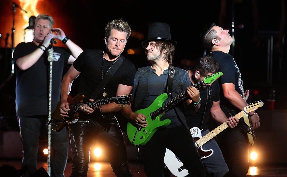 Band members rock out together Tuesday night. The country music trio Rascal Flatts were the headliners on the Grandstand Stage at the Illinois State Fairgrounds in Springfield on Tuesday evening, August 18, 2015. David Spencer/The State Journal-Register