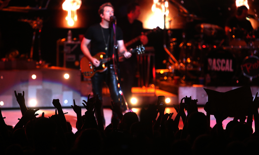 Raised hands of fans are silhouetted against the stage. The country music trio Rascal Flatts were the headliners on the Grandstand Stage at the Illinois State Fairgrounds in Springfield on Tuesday evening, August 18, 2015. David Spencer/The State Journal-Register