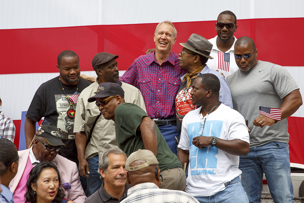 Gov. Bruce Rauner climbed into bleacher seats to pose for a photo with supporters at the Republican Day rally on the Director's Lawn at the Illinois State Fair Wednesday, Aug. 19, 2015. Rich Saal/The State Journal-Register