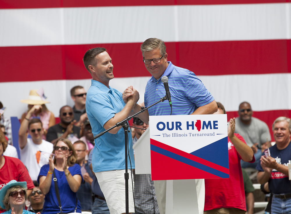 Congressman Rodney Davis, left, introduced fellow Congressman Randy Hultgren who spoke after him during the Republican Day rally on the Director's Lawn at the Illinois State Fair Wednesday, Aug. 19, 2015. Rich Saal/The State Journal-Register