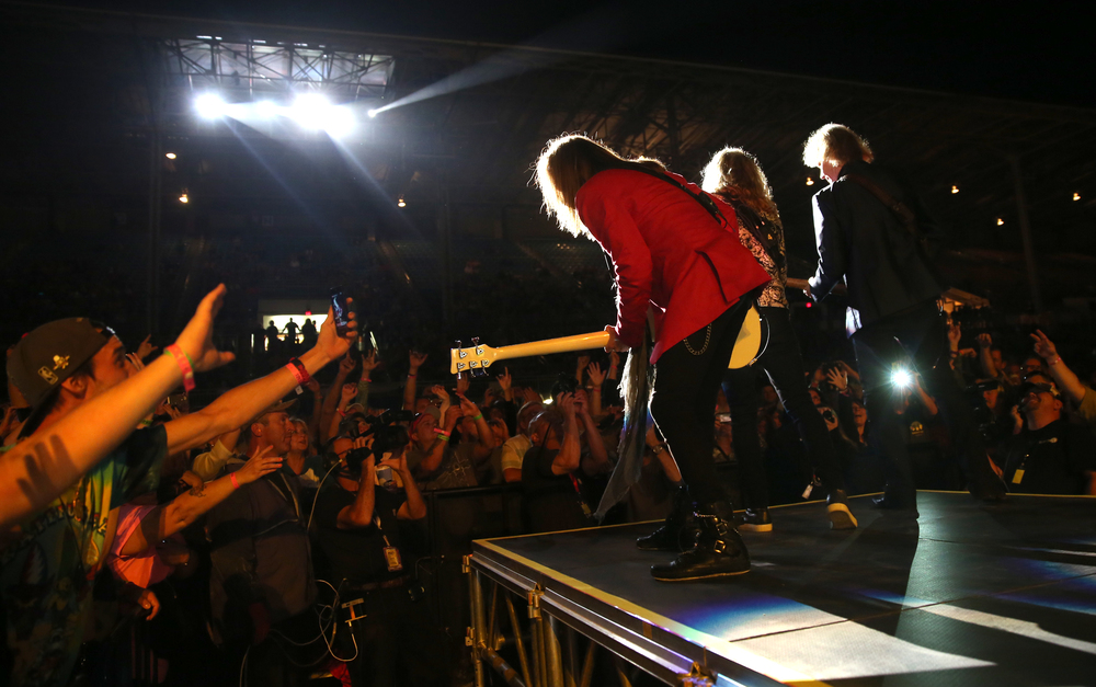 Ricky Phillips, Tommy Shaw and James Young perform on part of the stage which extended into the audience Wednesday night. The rock group Styx performed on the Grandstand Stage at the Illinois State Fairgrounds in Springfield on Wednesday evening, August 19, 2015. Tesla was the opening band for the evening. David Spencer/The State Journal-Register