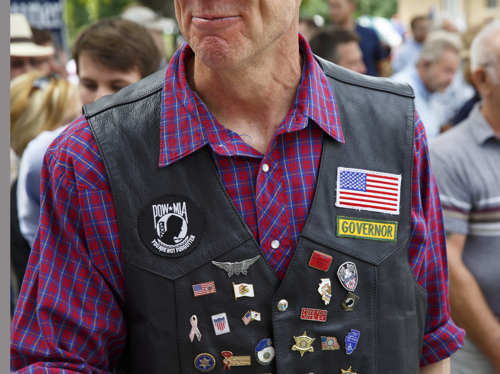 Gov. Bruce Rauner arrived at the Republican Day rally at the Illinois State Fairgrounds on his Harley Davidson motorcycle, wearing a leather personalized for the governor Wednesday, Aug. 19, 2015. Rich Saal/The State Journal-Register