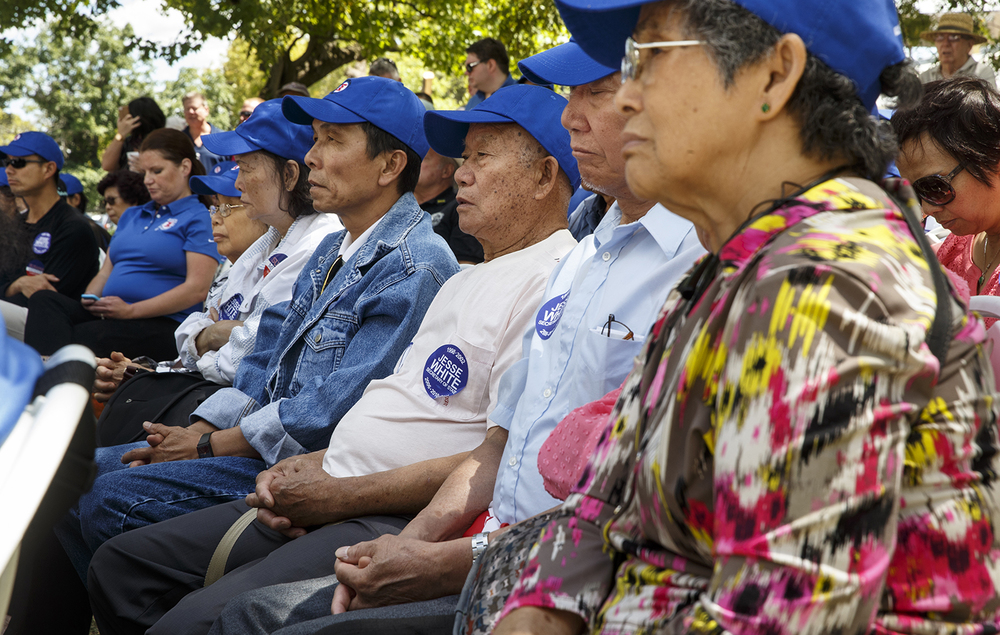 Members of from the Chinese Mutual Aid Association listen to speakers at a Democrat Day rally at the Illinois State Fair Thursday, Aug. 20, 2015. Ted Schurter/The State Journal-Register