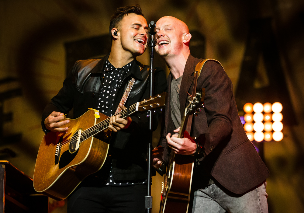 Joe King, left, and Isaac Slade, right, of The Fray share a microphone as they perform with the band during their Grandstand concert at the Illinois State Fairgrounds, Thursday, Aug. 20, 2015, in Springfield, Ill. Justin L. Fowler/The State Journal-Register
