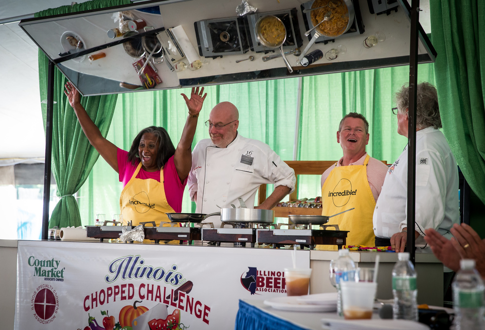 Ward 3 Ald. Doris Turner, left, celebrates with Chef Michael Taylor, of 16 Plates, after winning the Illinois Chopped Challenge against Sangamon County Recorder Josh Langfelder, right, and Chef Michael Higgins, of Maldaner's, during the Illinois State Fair, Thursday, Aug. 20, 2015, in Springfield, Ill. Justin L. Fowler/The State Journal-Register