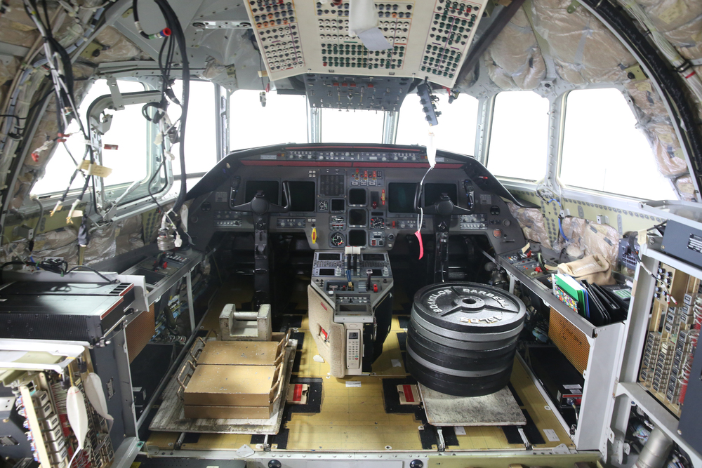 An interior view showing the cockpit of a Falcon 2000 corporate jet being completely refurbished at the airport. The large weights seen at right where one of the seats has been removed is to counterbalance the aircraft while parts have been temporarily removed during the work. David Spencer/The State Journal-Register