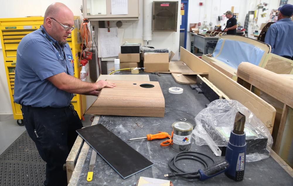 StandardAero cabinet shop employee Adam Hunt works on a cabinet surround for a sound system speaker. David Spencer/The State Journal-Register