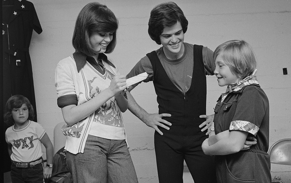 1976: Donnie and Marie Osmond visit with Anna Marie Maguire backstage at the Grandstand before their concert.