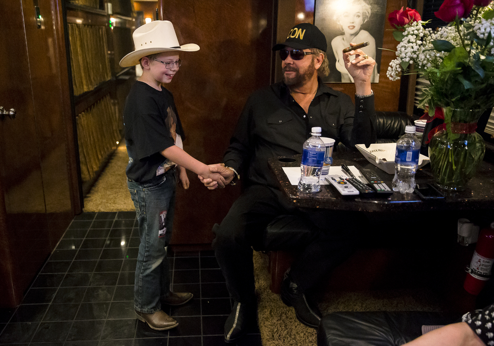 "Timmy Lynch, 9, gets the chance to meet Hank Williams Jr. on his tour bus for a Meet & Greet prior to the Grandstand concert at the Illinois State Fair, Friday, Aug. 21, 2015, in Springfield, Ill. After seeing a video performance of ""There's a Tear in My Beer"" by Lynch during a karaoke night, Williams Jr. invited him on his tour bus for a quick introduction prior to the concert. Justin L. Fowler/The State Journal-Register"