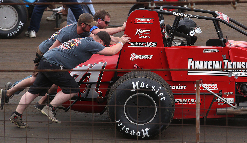 "Crew members for Shane Cockrum of Benton, IL push Cockrum forward after first getting the word to ""start your engines"". David Spencer/The State Journal-Register"