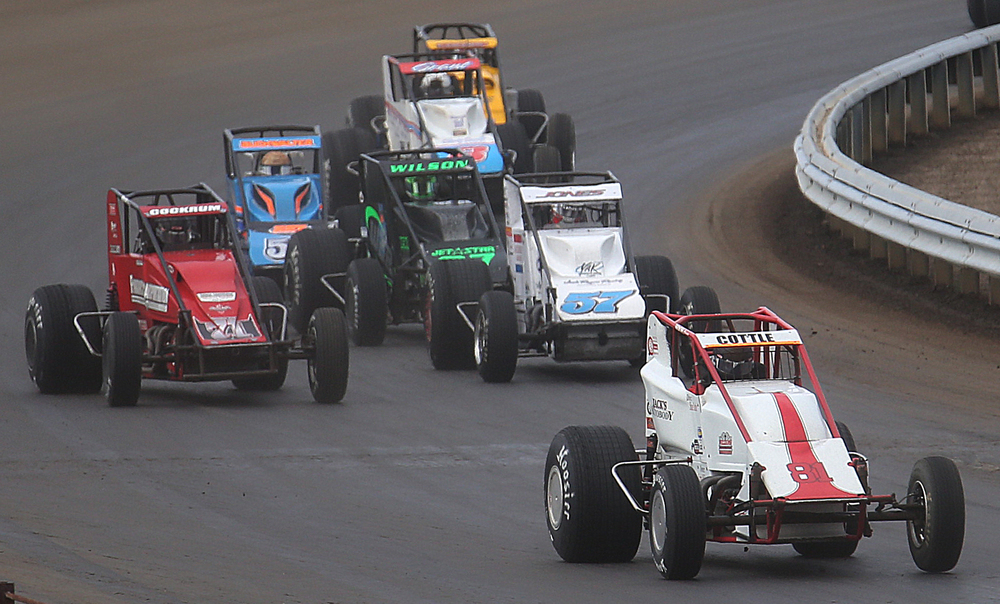 Shane Cottle of Kokomo, IN driving car #81 is in front of Levi Jones of Swansea, IL (car #57) late in the race. David Spencer/The State Journal-Register