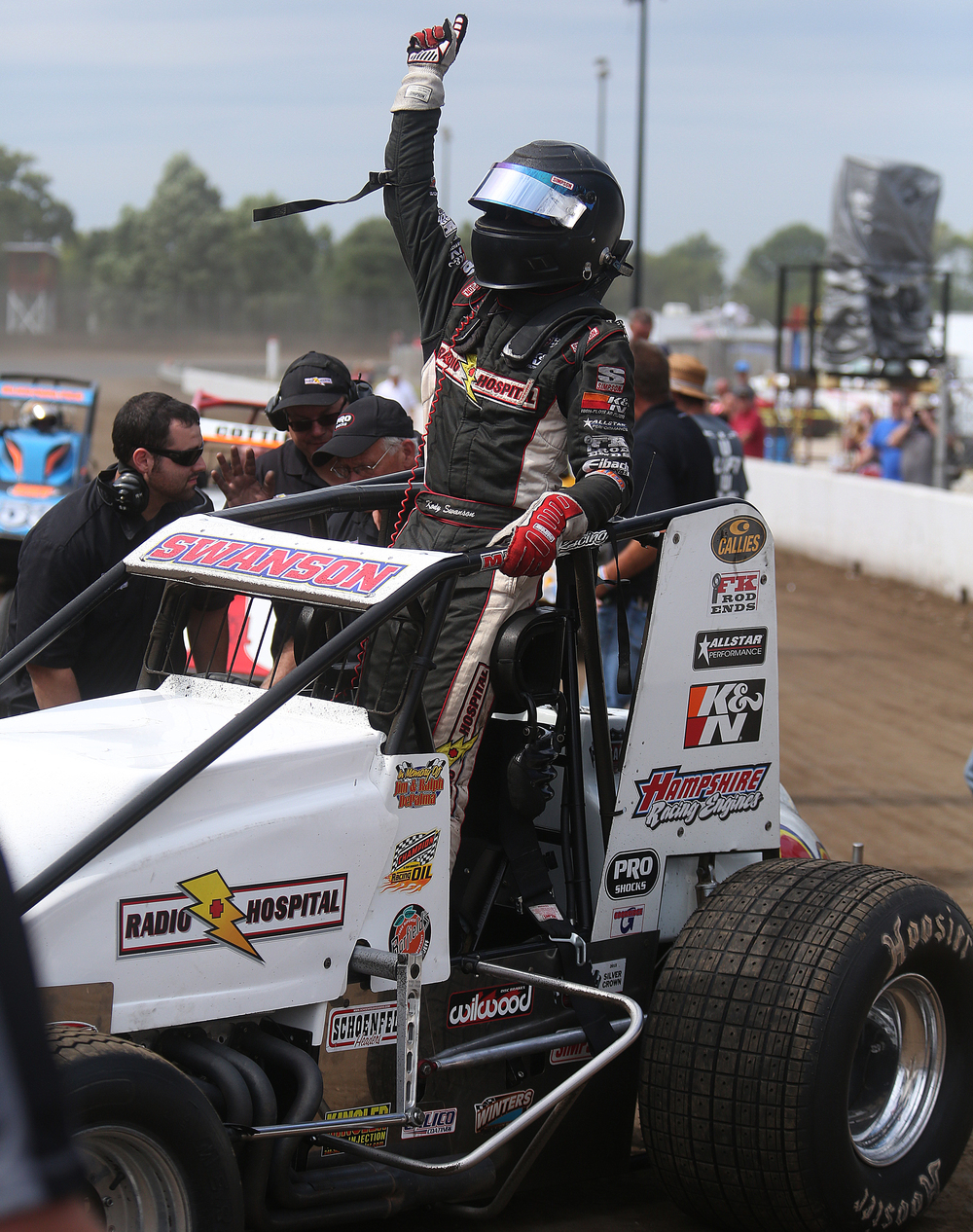 Kody Swanson of Kingsburg, CA raises his fist in victory while getting out of his car in victory lane. David Spencer/The State Journal-Register