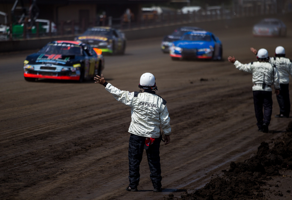Officials wave to the drivers as they come by prior to the start of the SuperChevyStores.com 100/Allen Crowe Memorial at the Illinois State Fair, Sunday, Aug. 23, 2015, in Springfield, Ill. Justin L. Fowler/The State Journal-Register