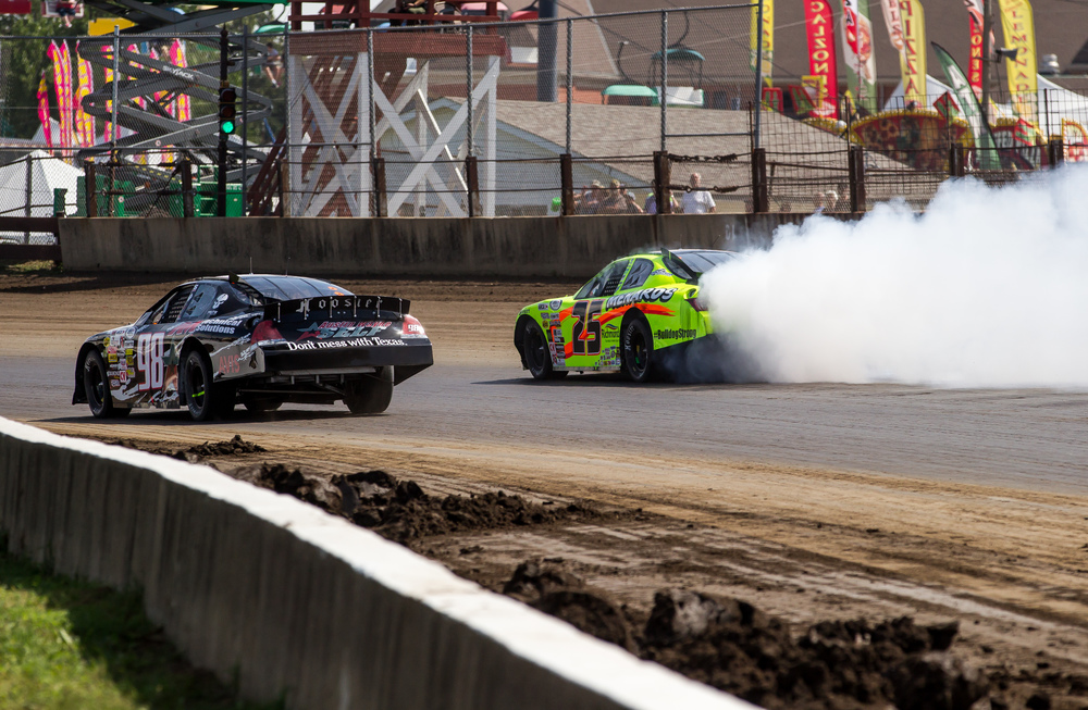 Smoke pours from Frank Kimmel's Ansell Menards Toyota as he takes it into turn one during the SuperChevyStores.com 100/Allen Crowe Memorial at the Illinois State Fair, Sunday, Aug. 23, 2015, in Springfield, Ill. Justin L. Fowler/The State Journal-Register