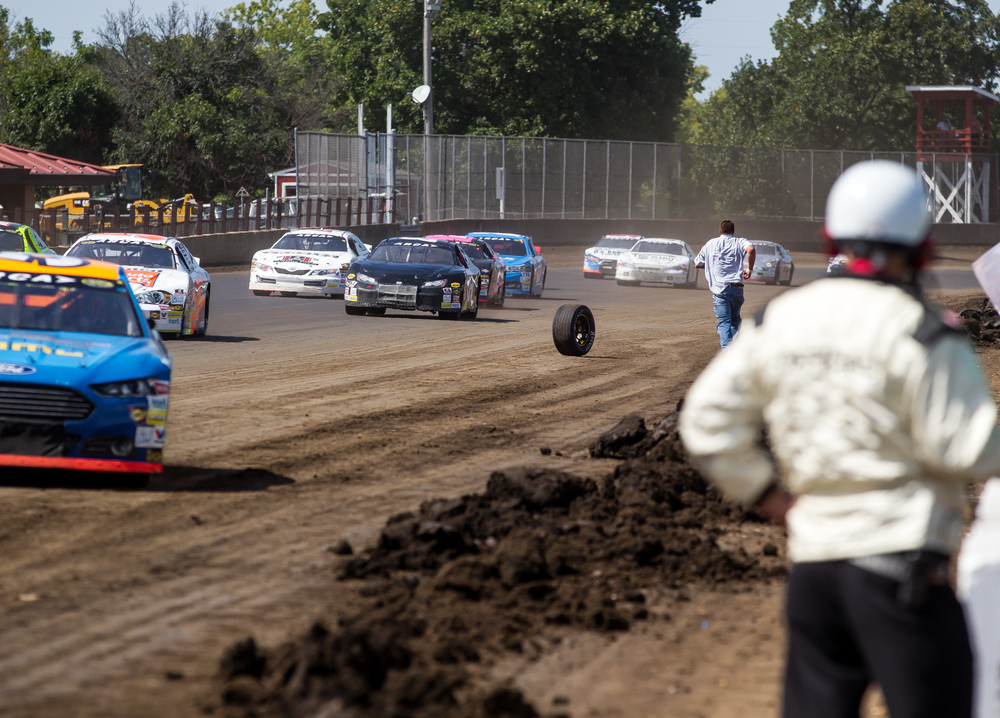 A tire rolls out on to the track from a car coming into pit lane under caution during the SuperChevyStores.com 100/Allen Crowe Memorial at the Illinois State Fair, Sunday, Aug. 23, 2015, in Springfield, Ill. Justin L. Fowler/The State Journal-Register