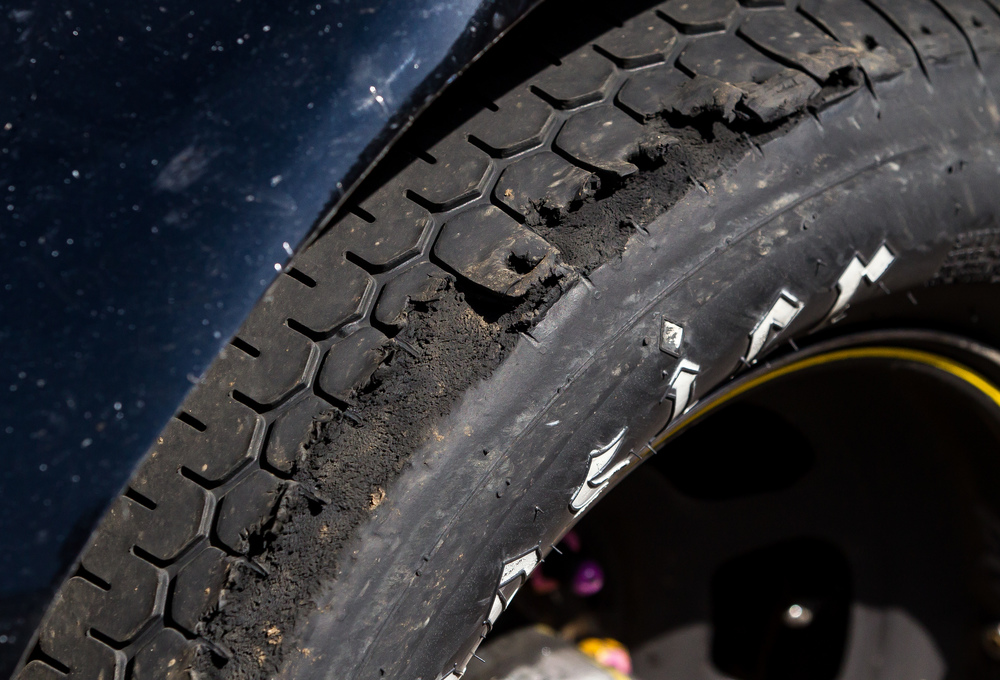 The driver's side front tire of A.J. Fike's Liberty Village-Office Specialists Ford shows its wear from the race as the car sits in victory lane during the SuperChevyStores.com 100/Allen Crowe Memorial at the Illinois State Fair, Sunday, Aug. 23, 2015, in Springfield, Ill. Justin L. Fowler/The State Journal-Register