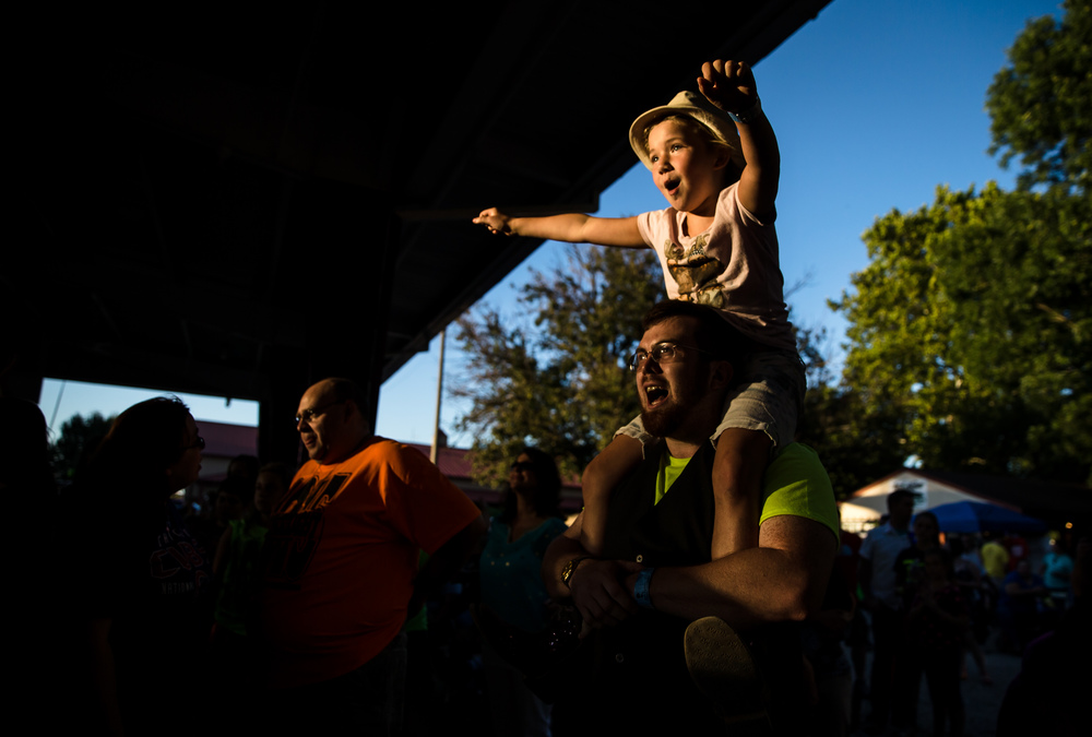 Addy Lewis, 8, dances on the shoulders of Brian Morgan as the Christian rock group Hawk Nelson performs on the Lincoln Stage during the 24th Powerlight Fest at the Illinois State Fair, Sunday, Aug. 23, 2015, in Springfield, Ill. The Powerlight Fest is a Christian music festival organized by Greg Cooper and has been a mainstay at the Illinois State Fair since it moved from Knights Action Park in 1991. Justin L. Fowler/The State Journal-Register