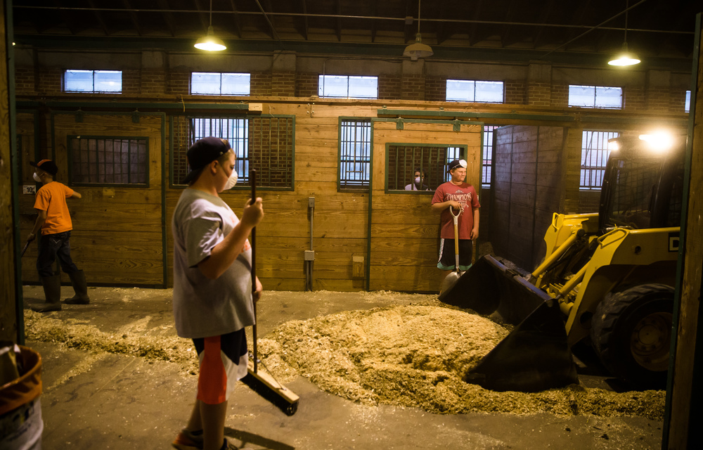 As the fair draws to a close the Rochester junior high 13U baseball team helps clean the barns as a fundraiser at the Illinois State Fair, Sunday, Aug. 23, 2015, in Springfield, Ill. Justin L. Fowler/The State Journal-Register