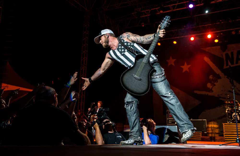 Brantley Gilbert reaches out to shake hands with his fans as he performs on the Grandstand stage at the Illinois State Fair, Sunday, Aug. 23, 2015, in Springfield, Ill. Justin L. Fowler/The State Journal-Register