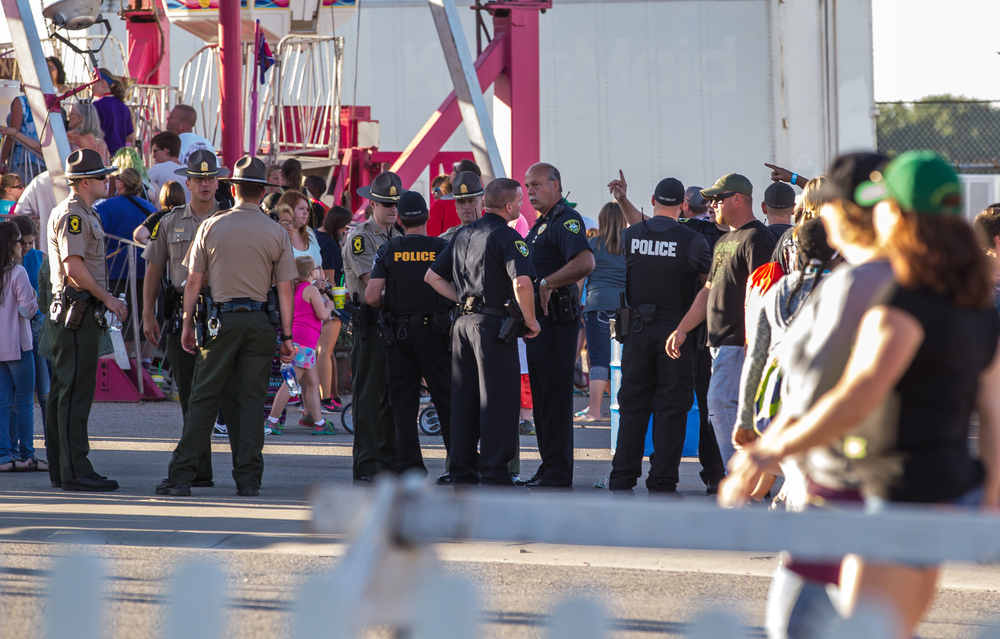 A heavy police presence at the Illinois State Fair with a large crowd expected for the Brantley Gilbert concert, Sunday, Aug. 23, 2015, in Springfield, Ill. Justin L. Fowler/The State Journal-Register