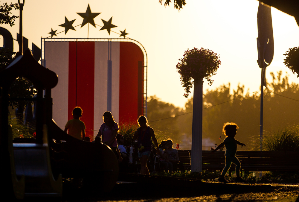 Children take advantage of the last bit of sunlight in the playground above Happy Hollow at the Illinois State Fair, Sunday, Aug. 23, 2015, in Springfield, Ill. Justin L. Fowler/The State Journal-Register